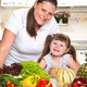 happy mother and daughter smiling in the kitchen - PhotoDune Item for Sale