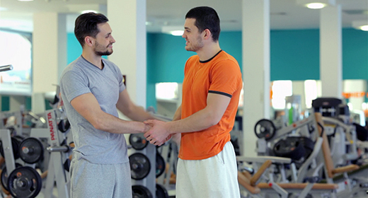Sports Training Two Guys In The Gym
