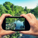 Man and woman hand capturing beautiful city park with smartphone - PhotoDune Item for Sale