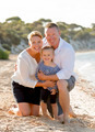 beautiful family couple wife and husband holding little daughter on beach - PhotoDune Item for Sale