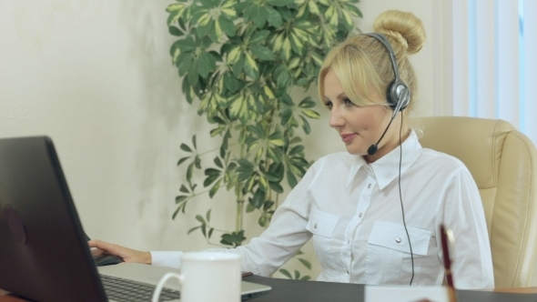 Beautiful Blonde In The Office With Headphones