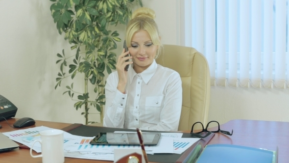 Attractive Girl In The Office Talking On a Cell