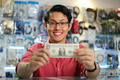 Happy Chinese Man Showing First Dollar Earning In PC Shop - PhotoDune Item for Sale