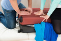 Couple Together Packing Luggage - PhotoDune Item for Sale