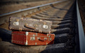 The image of forgotten suitcases on railway tracks.  - PhotoDune Item for Sale