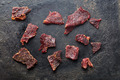 beef jerky on old black table - PhotoDune Item for Sale