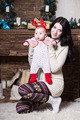 Young woman posing with her baby - PhotoDune Item for Sale