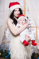 Pretty woman posing with her baby - PhotoDune Item for Sale