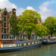 Amsterdam canal with houseboats, Holland - PhotoDune Item for Sale