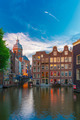 Evening Amsterdam canal, church and bridge - PhotoDune Item for Sale