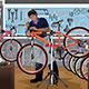Bike Repairman Repairing a Bicycle in His Shop - GraphicRiver Item for Sale