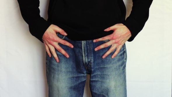 Man Turns The Empty Pockets Of His Jeans No Money