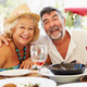 Senior Couple Enjoying Meal In Outdoor Restaurant - PhotoDune Item for Sale