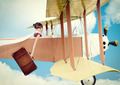 Girl with suitcase flying vintage plane. Photo in old image style. - PhotoDune Item for Sale