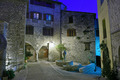 Narrow cobbled street in old town Peille at night, France. - PhotoDune Item for Sale