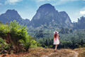 Girl goes on a footpath in the tropics of Thailand - PhotoDune Item for Sale