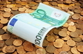 Banknotes of one hundred euros on coins - PhotoDune Item for Sale