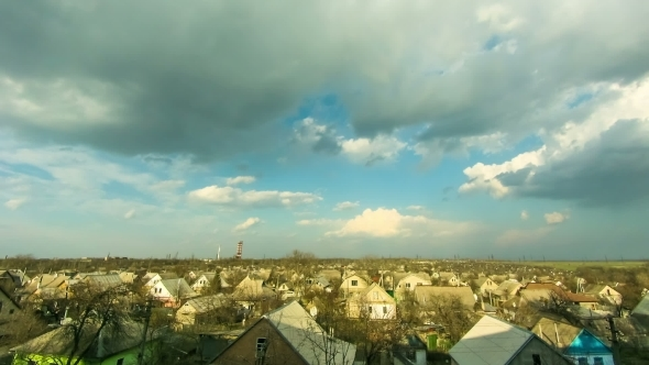 Clouds In The Sky Moving Over Houses