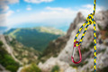 rock climbing rope with hooks on a background of mountains - PhotoDune Item for Sale