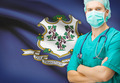 Surgeon with US state flag on background series - Connecticut - PhotoDune Item for Sale