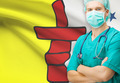 Surgeon with Canadian privinces flag on background series - Nunavut - PhotoDune Item for Sale