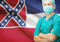 Surgeon with US state flag on background series - Mississippi - PhotoDune Item for Sale