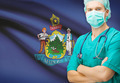 Surgeon with US state flag on background series - Maine - PhotoDune Item for Sale