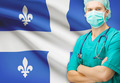 Surgeon with Canadian privinces flag on background series - Quebec - PhotoDune Item for Sale
