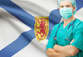 Surgeon with Canadian privinces flag on background series - Nova Scotia - PhotoDune Item for Sale