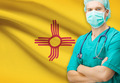 Surgeon with US state flag on background series - New Mexico - PhotoDune Item for Sale