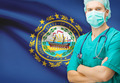 Surgeon with US state flag on background series - New Hampshire - PhotoDune Item for Sale
