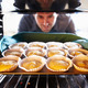Man Putting Cupcakes Into Oven To Bake - PhotoDune Item for Sale