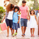 Family Walking Along Street With Shopping Bags - PhotoDune Item for Sale
