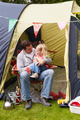 Father And Daughter Enjoying Camping Holiday On Campsite - PhotoDune Item for Sale