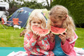 Children Enjoying Picnic Whilst On Family Camping Holiday - PhotoDune Item for Sale