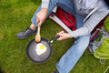 Man On Camping Holiday Frying Egg In Pan - PhotoDune Item for Sale