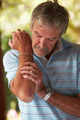 Mature Man Suffering From Painful Elbow At Home - PhotoDune Item for Sale