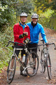 Two Mature Male Cyclists On Ride Looking At Mobile Phone App - PhotoDune Item for Sale