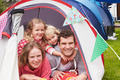 Family Enjoying Camping Holiday On Campsite - PhotoDune Item for Sale