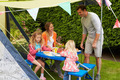 Family Enjoying Meal Outside Tent On Camping Holiday - PhotoDune Item for Sale