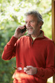Mature Man Using Cordless Phone At Home - PhotoDune Item for Sale