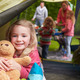 Girl With Teddy Bear Enjoying Camping Holiday On Campsite - PhotoDune Item for Sale