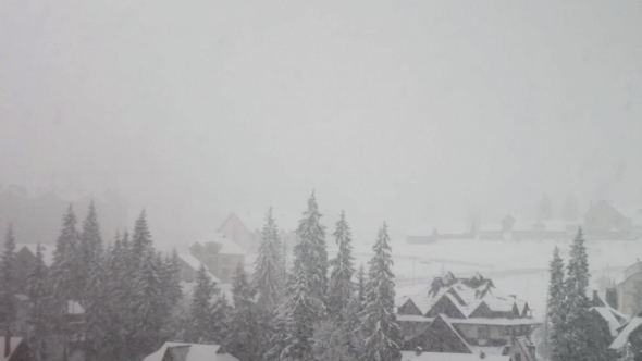 Heavy Snowfall On The Background Of Houses
