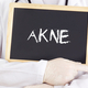 Doctor shows information on blackboard: acne in german - PhotoDune Item for Sale