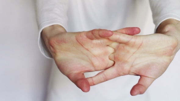 Man Shows Gestures And Signs With His Hands