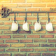 Coffee cups hanging on hooks in front of brick wall ( Filtered i - PhotoDune Item for Sale
