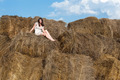 Young beautiful woman relaxes on hay - PhotoDune Item for Sale