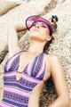 Beautiful fashionable woman in bikini in the rock - PhotoDune Item for Sale