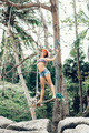Young happy woman having fun on a swing on a tropical beach - PhotoDune Item for Sale