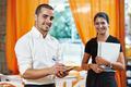 Waitress girl and waiter man in restaurant - PhotoDune Item for Sale